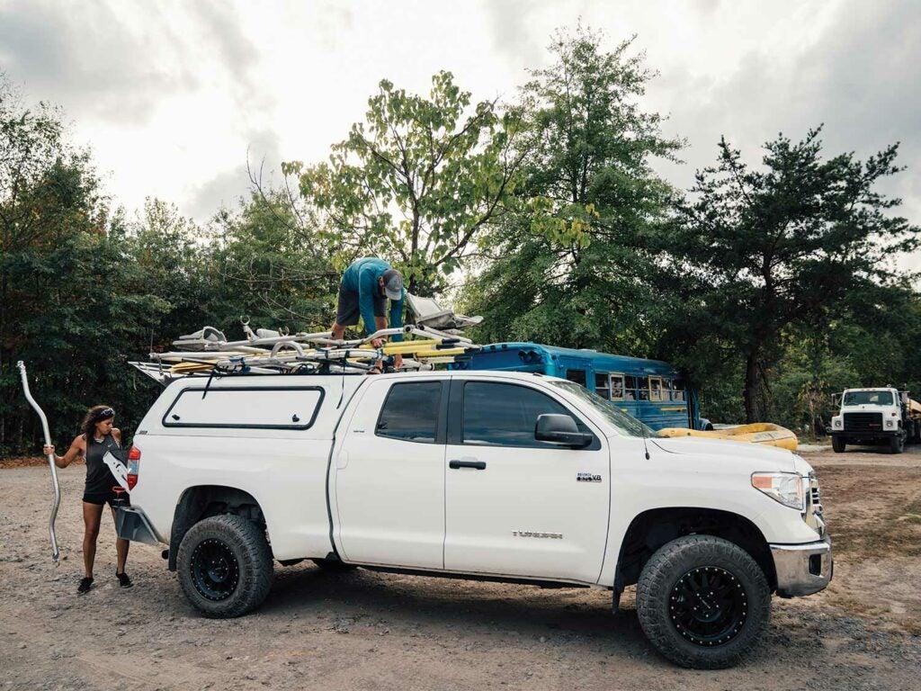 Natalie Krebs unloading fishing equipment and rafts.