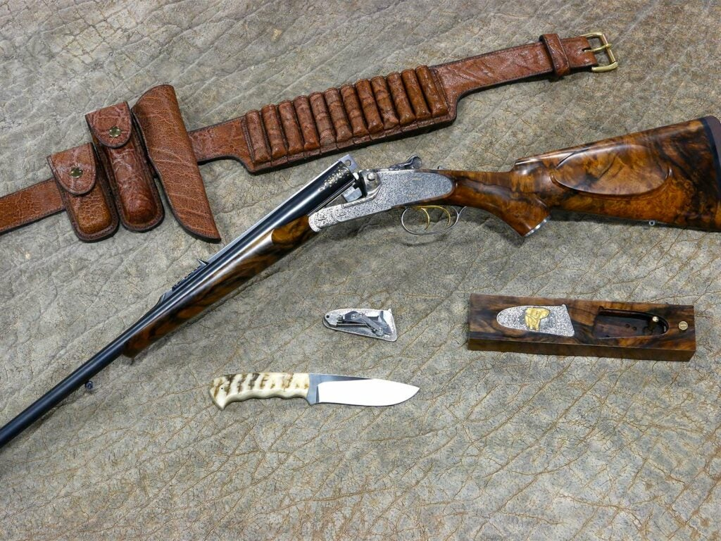 Collection of hunting gear and rifle.