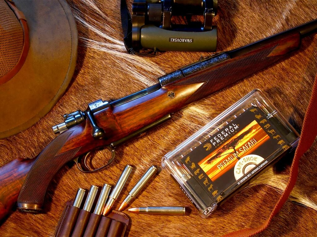 A rifle and hunting ammo and gear.