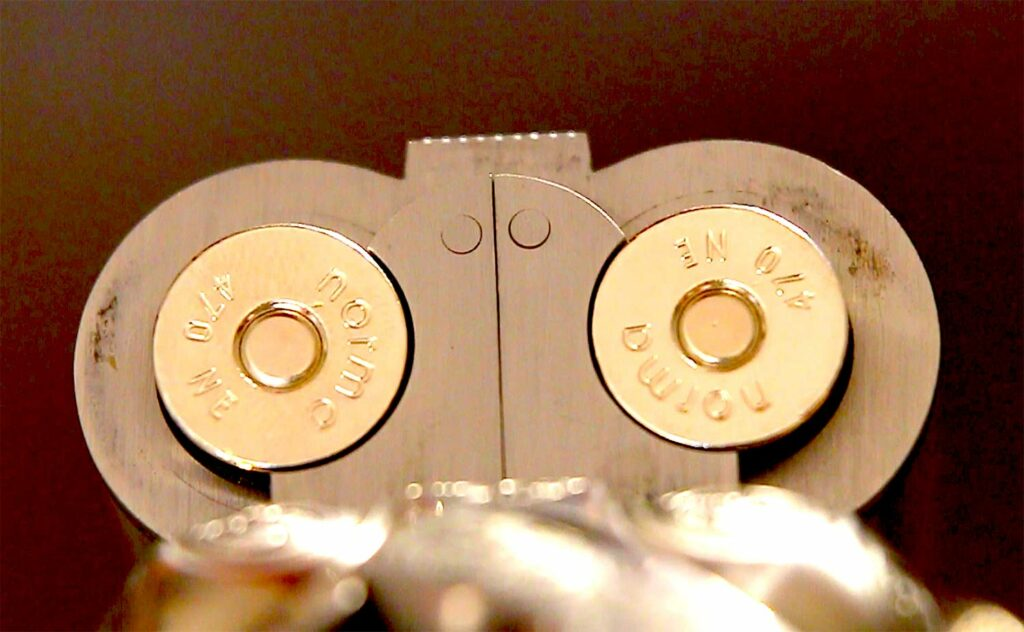 A loaded double rifle barrel.