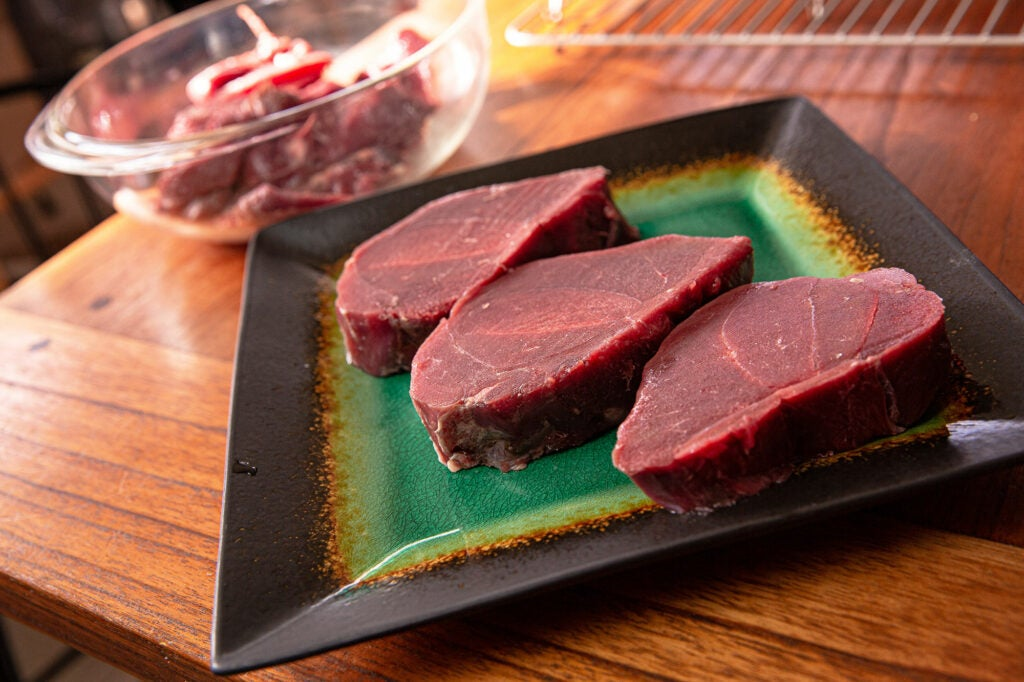 Cut wild game and venison steaks to a uniform thickness.