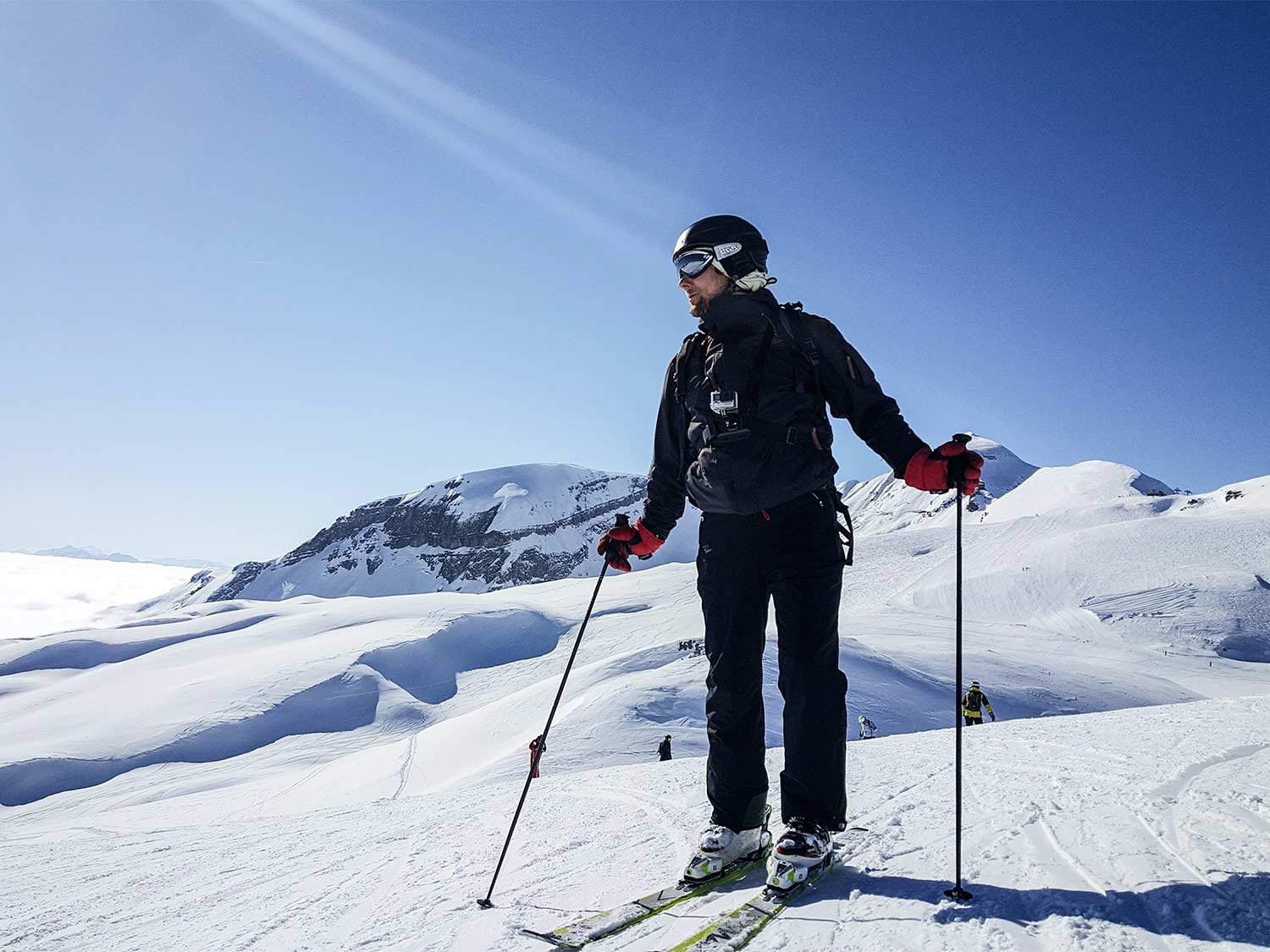A man wearing skis and the best snow pants on a snowy mountain side.