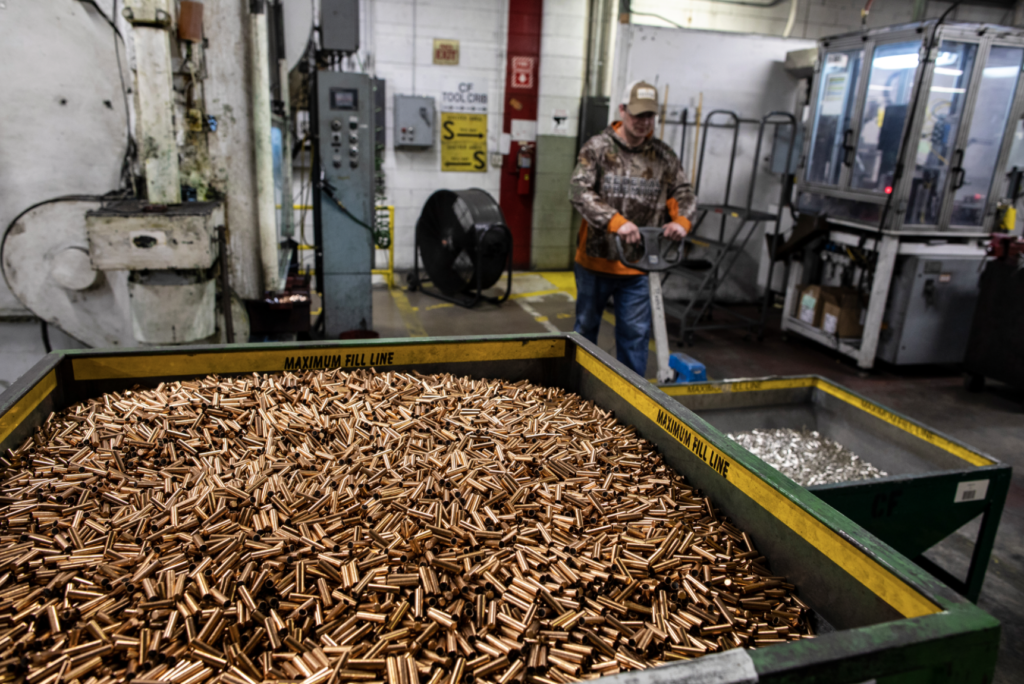 A worker behind a bin of cartridge brass at the Federal Premium Ammunition factory in Minnesota.