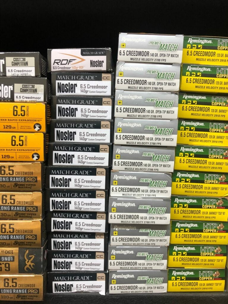A stockpile of 6.5 Creedmoor hunting ammunition in a variety of brands.