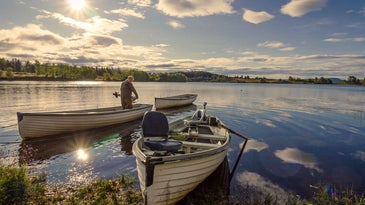 Three fishing boats on the water.