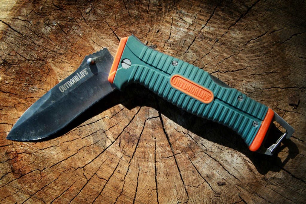 A partially unfolded camping folder knife, from Outdoor Life.