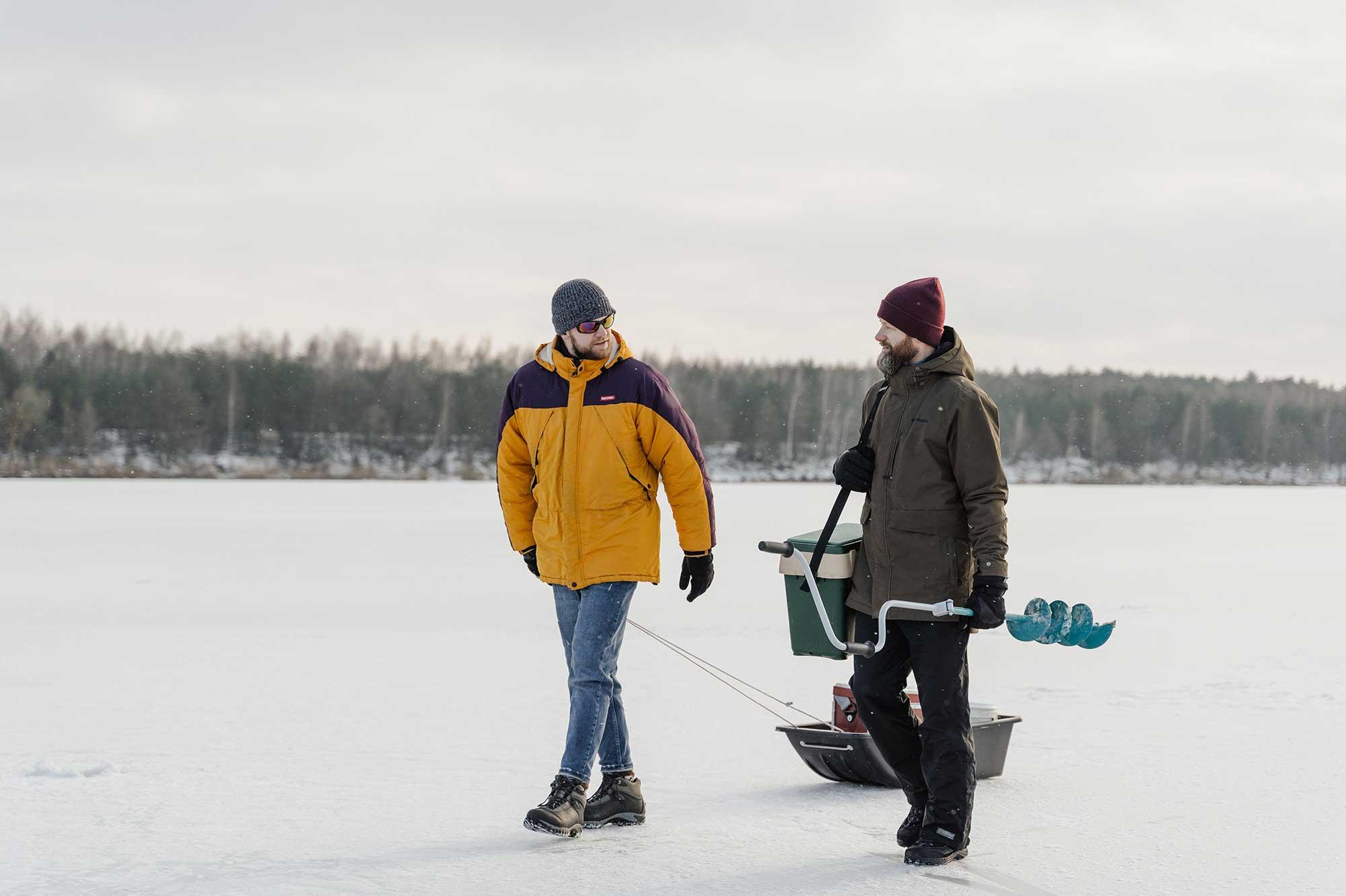 Two men walking on ice