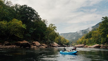 A rafter and his black Lab on the New River in West Virginia.