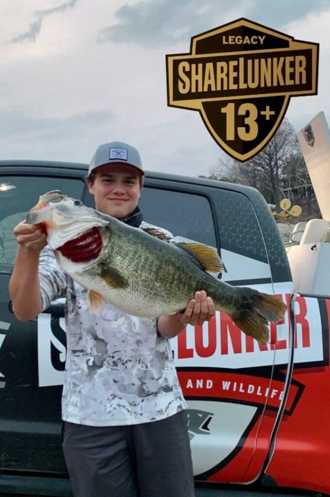 An angler holds up a largemouth bass.
