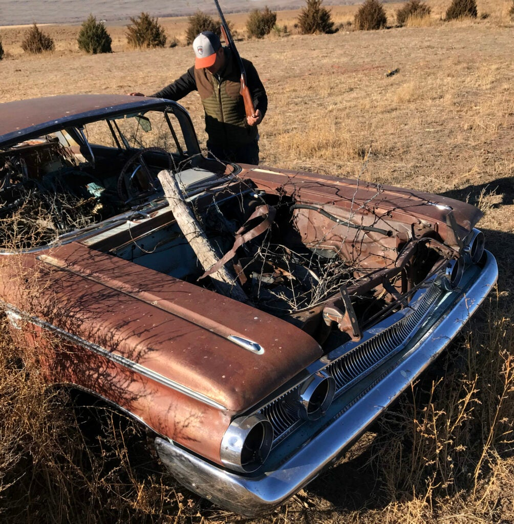 The rusted out hood of a Mercury Monterey car on a ranch in Eastern Colorado.