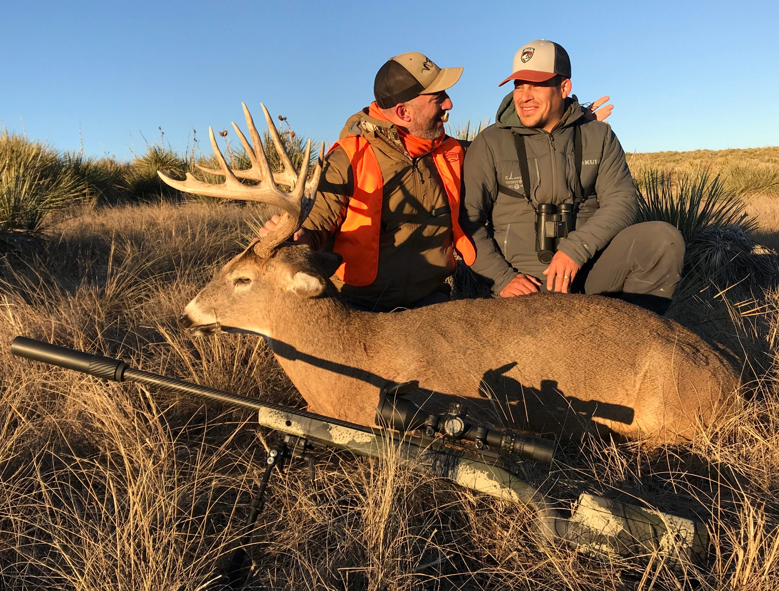 Two hunters sit behind a nice whitetail buck in Eastern Colorado.