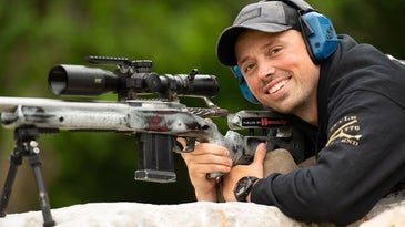 A competitive shooter behind a rifle on a bipod, having fun and not worrying about performing well in a competition.