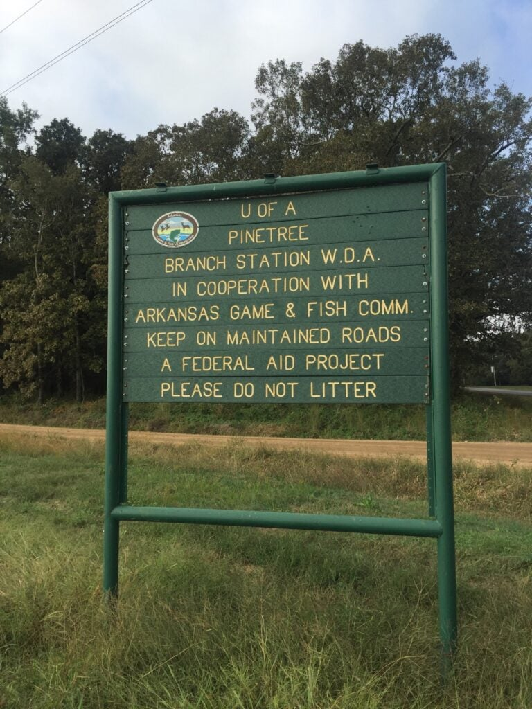 A sign at the Pine Tree Research Station, a chunk of public land in eastern Arkansas that the university is trying to sell.