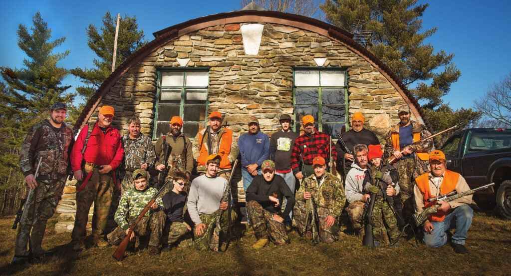 A group of New England deer hunters at their deer camp.
