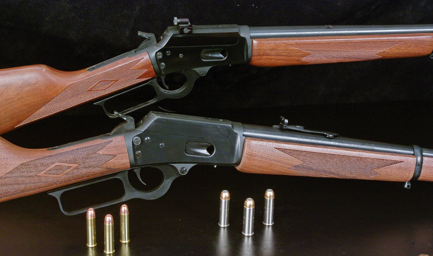 A pair of Marlin carbine rifles on a black background.
