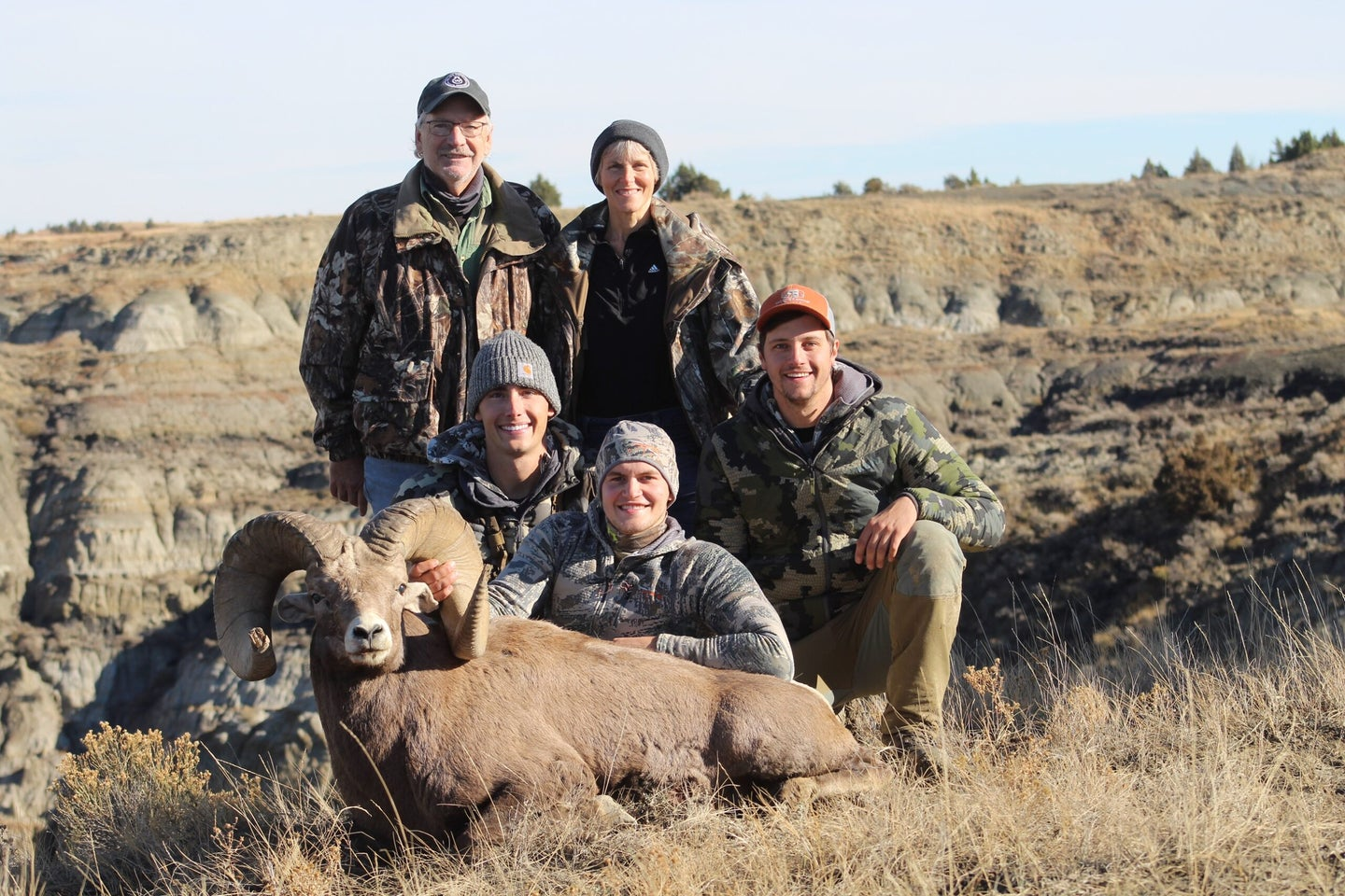 A group of hunters with a new record North Dakota ram.