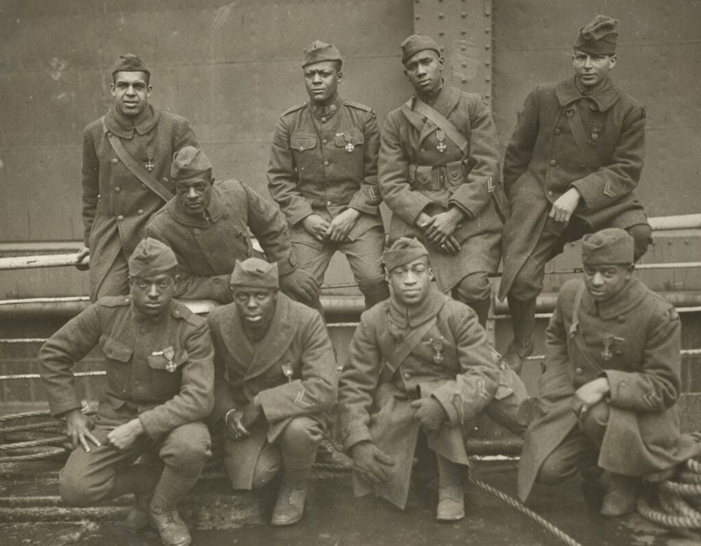Nine members of the Harlem Hellfighters from WWI.