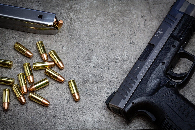 Winchester Defense Ready ammo beside a Springfield Armory handgun.