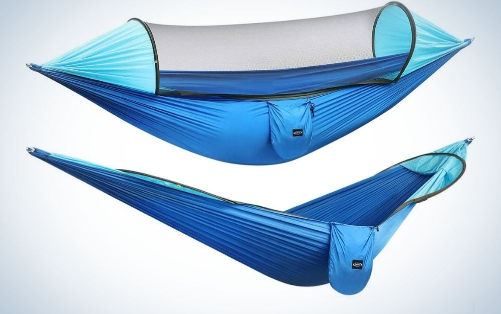A blue large camping hammock with transparent mosquito parachute and a blue hanging hammocks tree straps swing hammock bed.