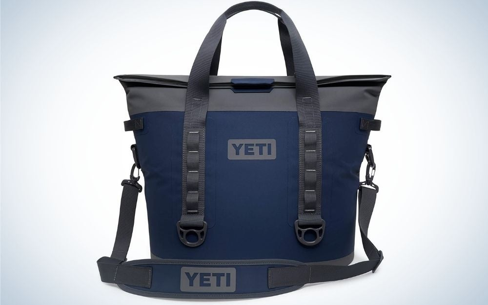 A dark blue and grey soft coolest bag with two holders and with no chains.