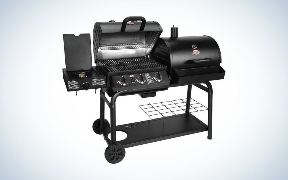 Black charcoal grill with gas and three burners