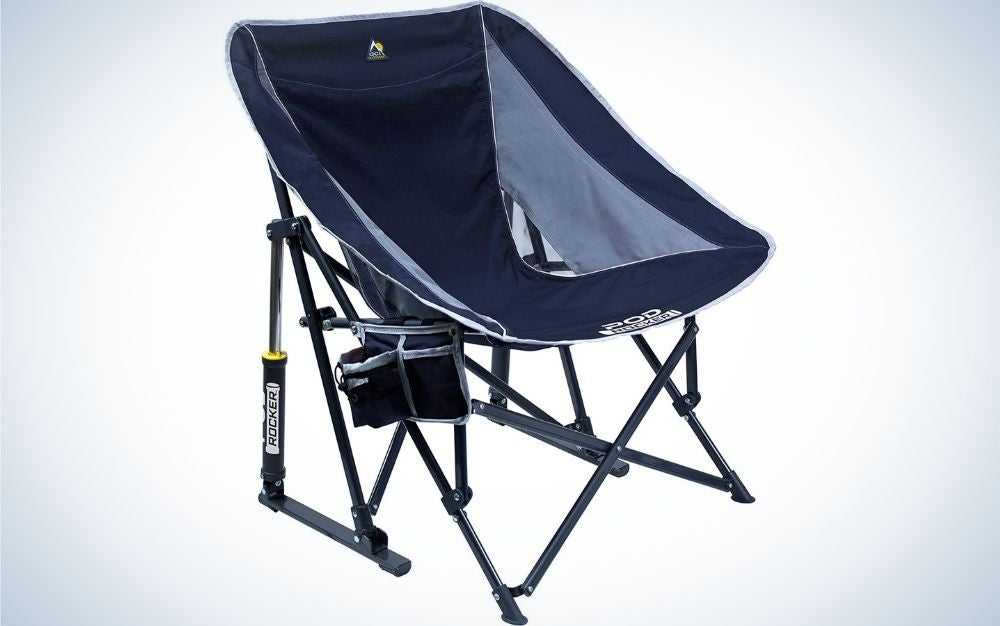 A blue portable outdoor rocking chair arched seat that folds flat for storage and transportation with a small bag and