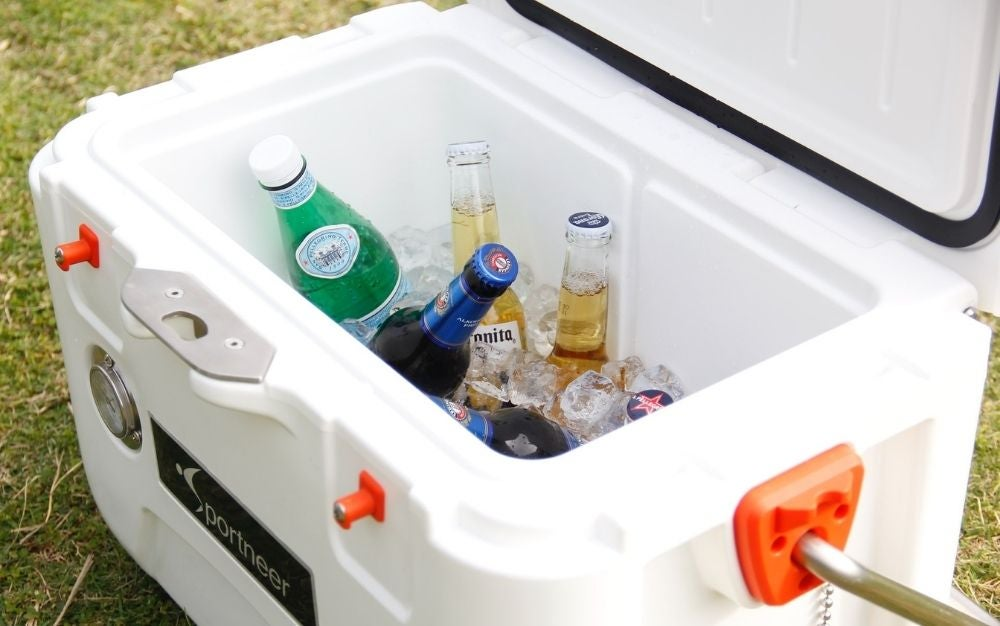 A white box cooler with different kind of drinks into it.