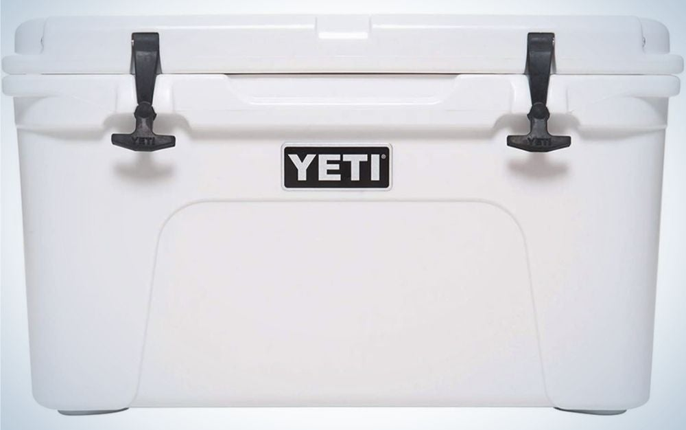 A white big box cooler Yeti with black key locker in front of the box.