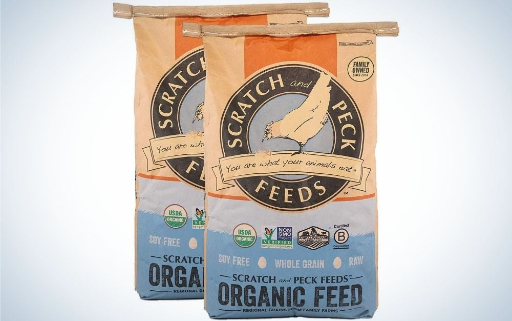Two packing scratch feeds peck with organic feed written into the front of the packs.