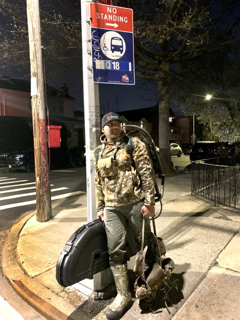 Cliff Cadet waits for an NYC bus.