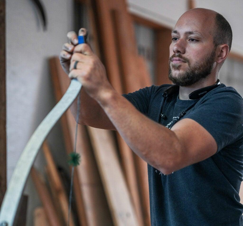 Trent Wengerd working in his shop.