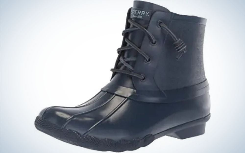 Navy rubber sole material boots with laces for fastening from side.