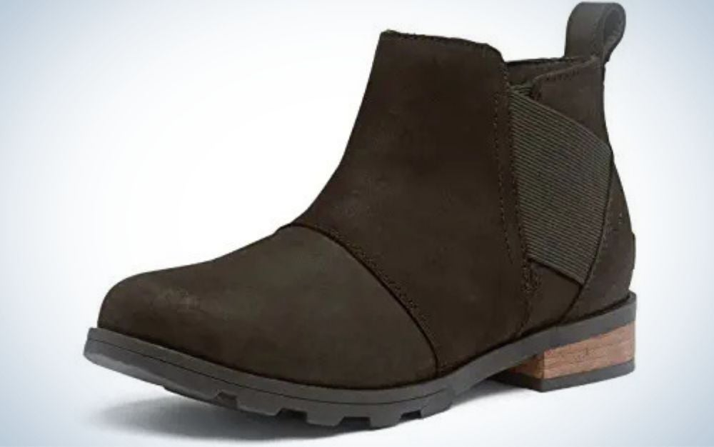 Dark brown full-grain leather boots with flat brown wooden heel from side.