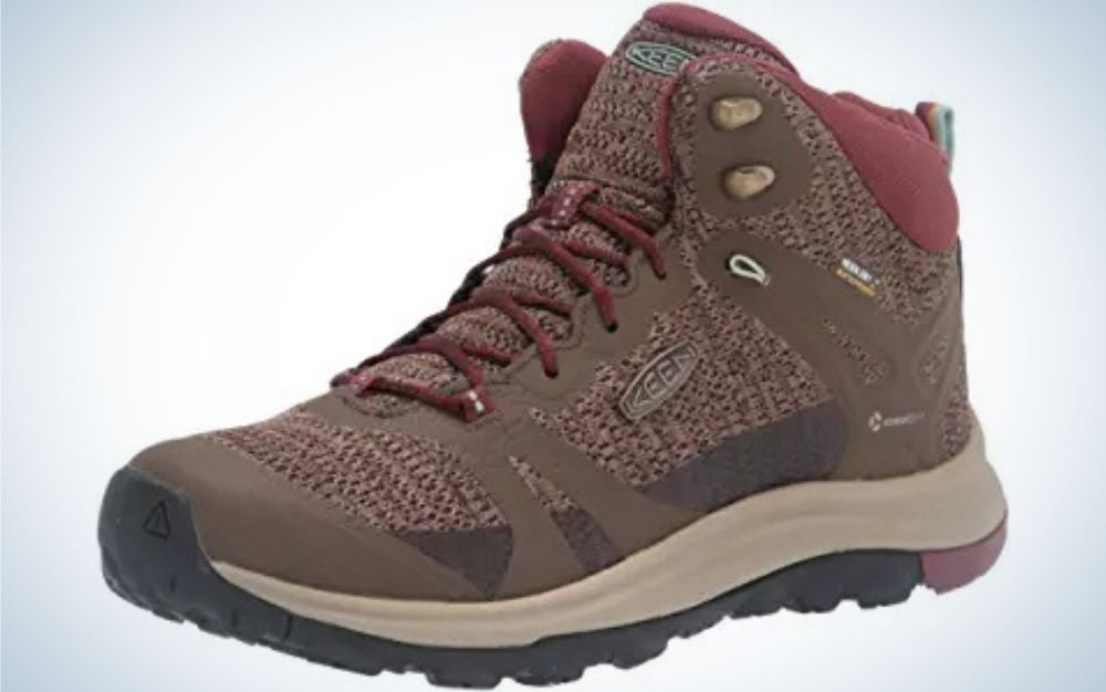 Canteen and Andorra colored rubber sole material boots with mid height heel from side.