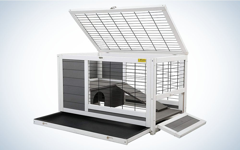 A white and gray bunny hutch with a removable tray and wire fencing.