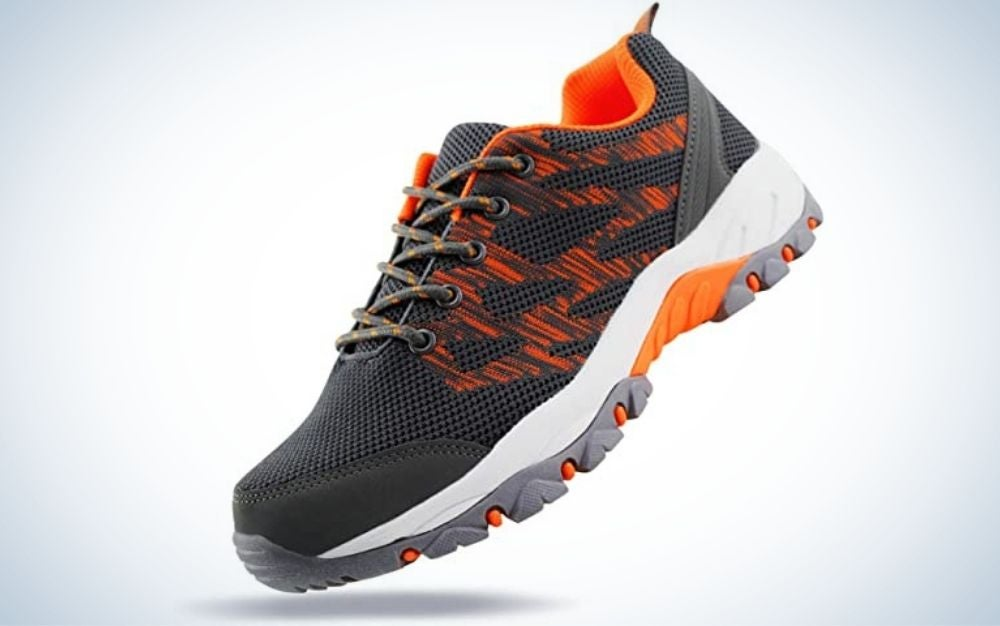 Thick gray hiking sneakers with gray laces with orange dots and gray, white and orange rubber.