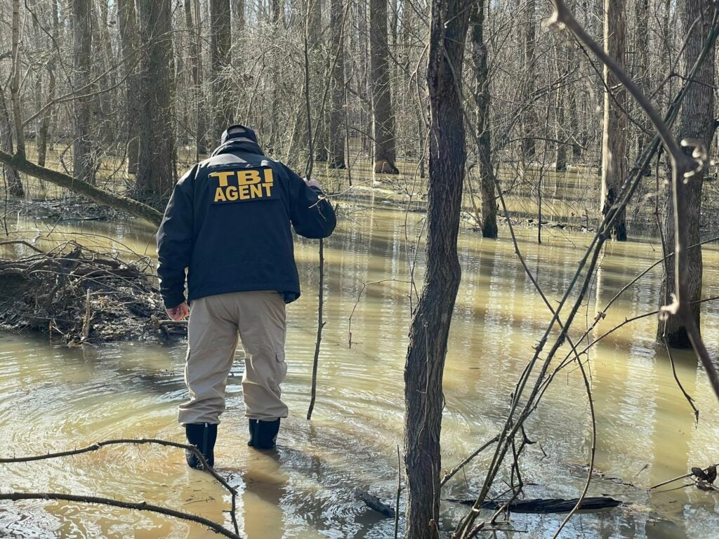 A TBI agent searches for David Vowell's body.