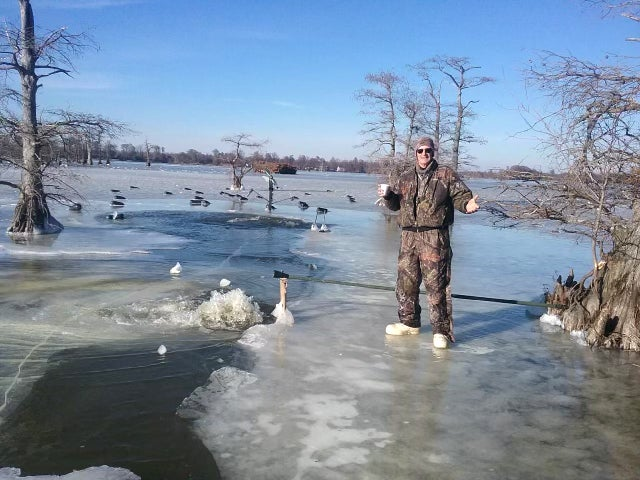 Vowell standing on the ice of Reelfoot Lake.