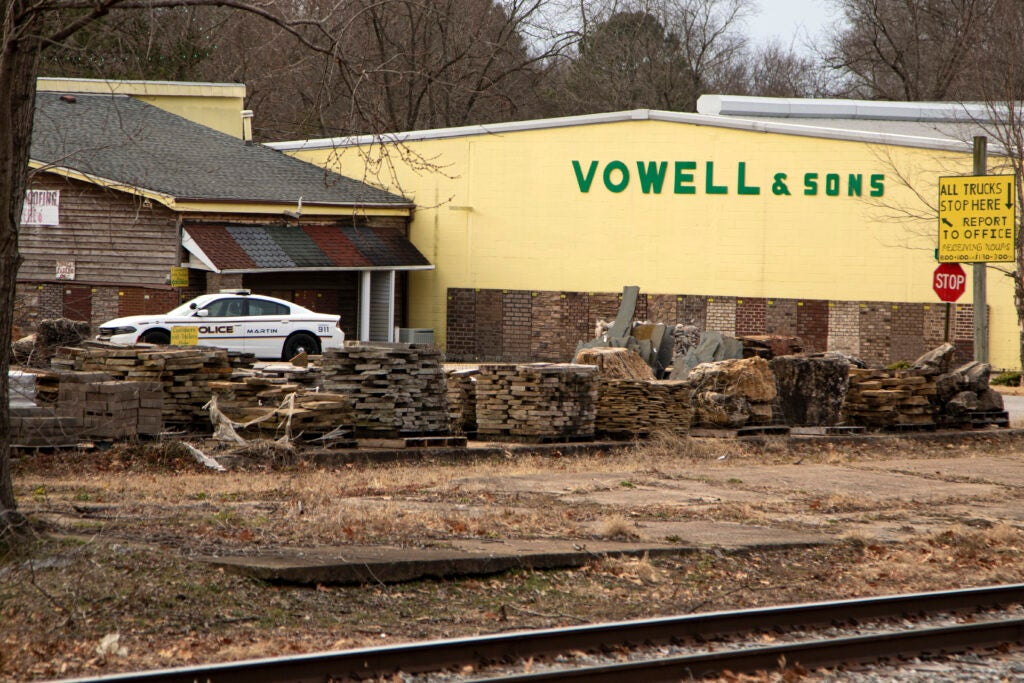 Martin police car parked outside Vowell and Sons, David Vowell's family business.