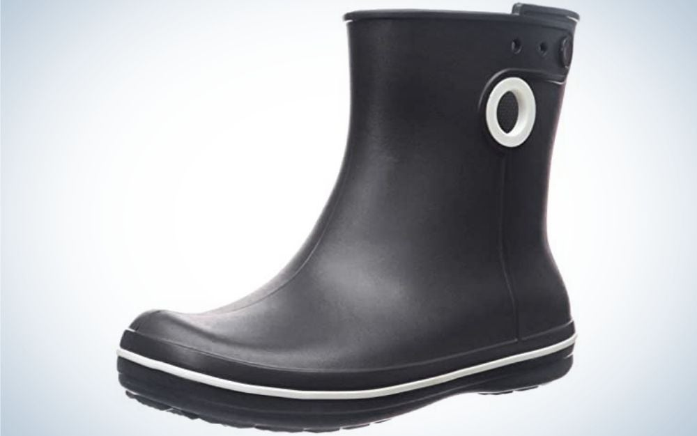 All black boots with a white circle on top of it and a white line around the boots.