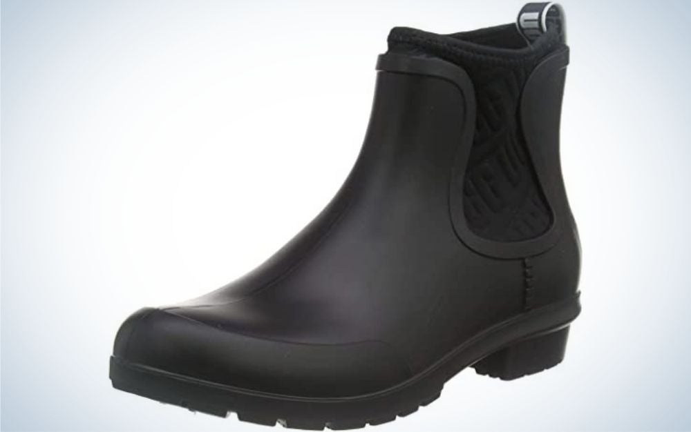 All black leather boots three-quarters with a item written in white behind it.