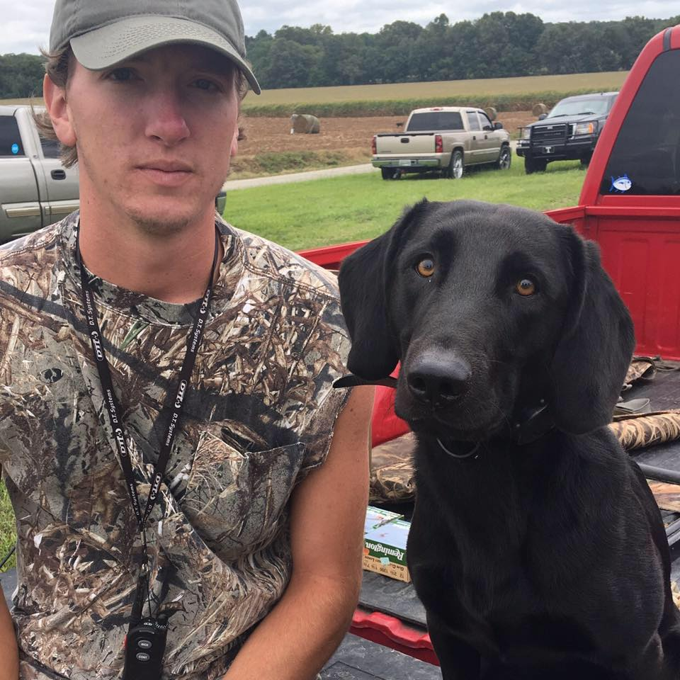 Grooms with his duck dog Avery.