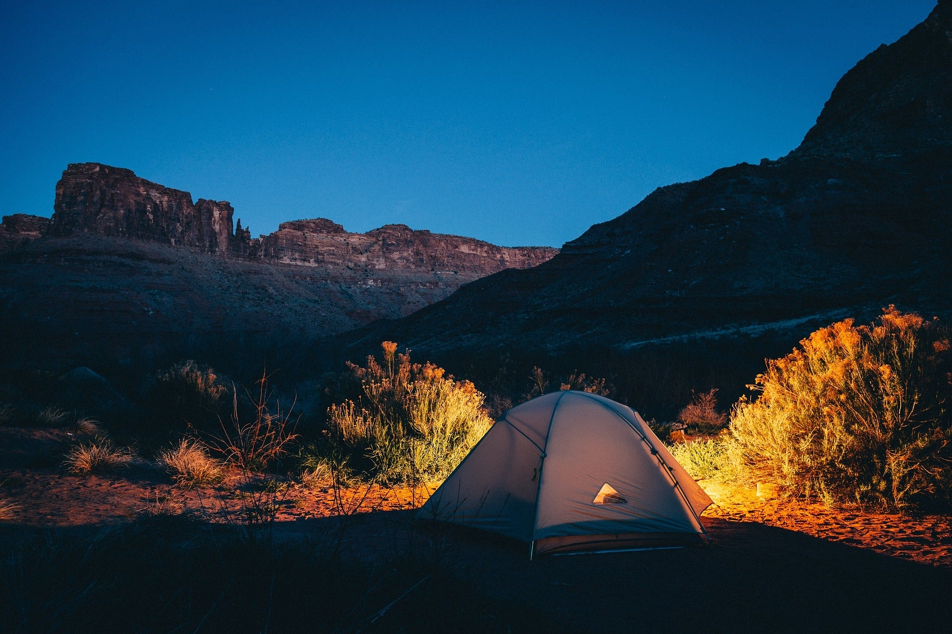 Keep the bugs away while camping by selecting the right location.