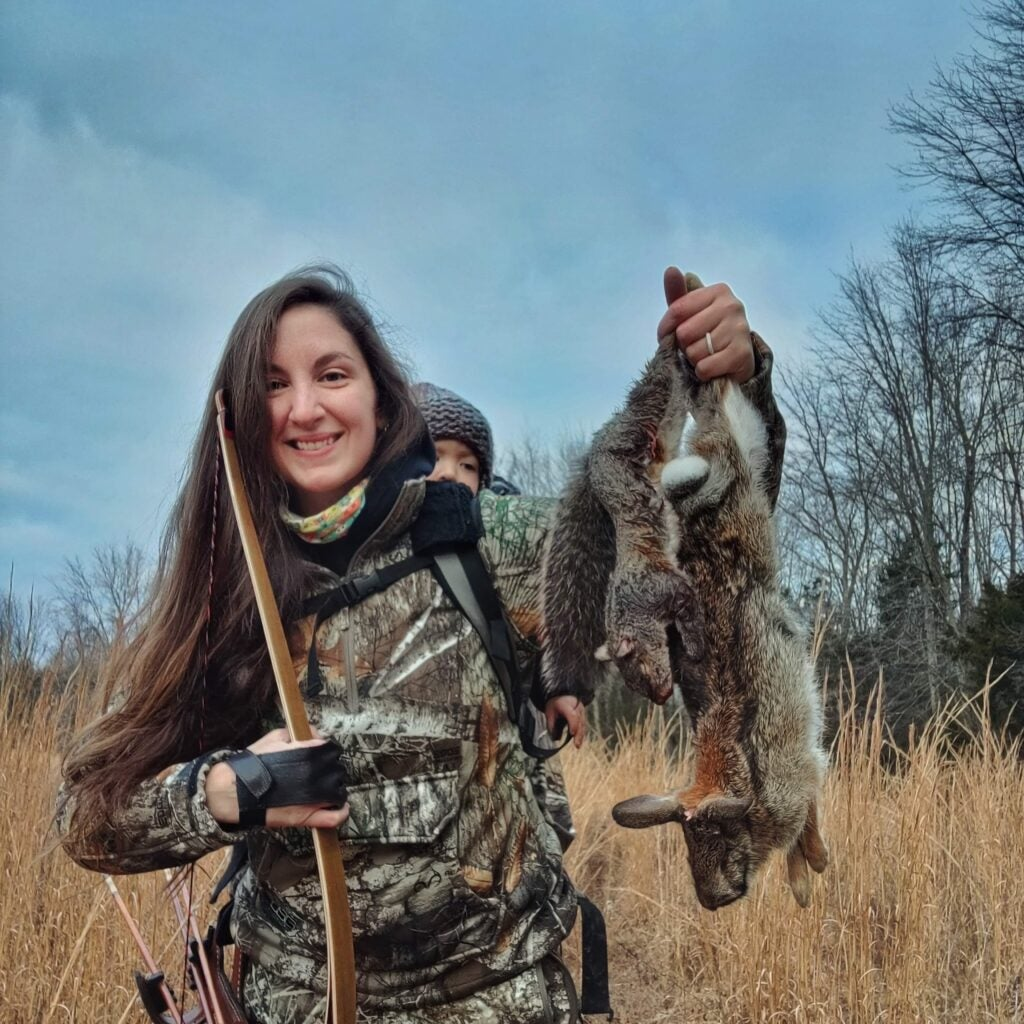A bowhunter hunting with her daughter for small game.
