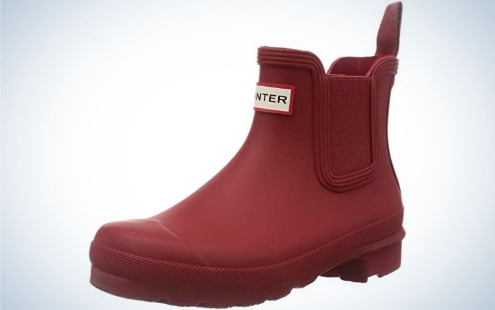 A matte plastic boots in cherry color and with the brand name on it.