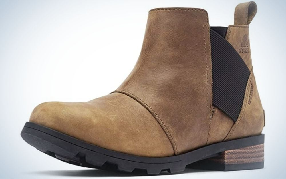 A winter brown boot with a strong black sole and a black elastic on the side of the boot.