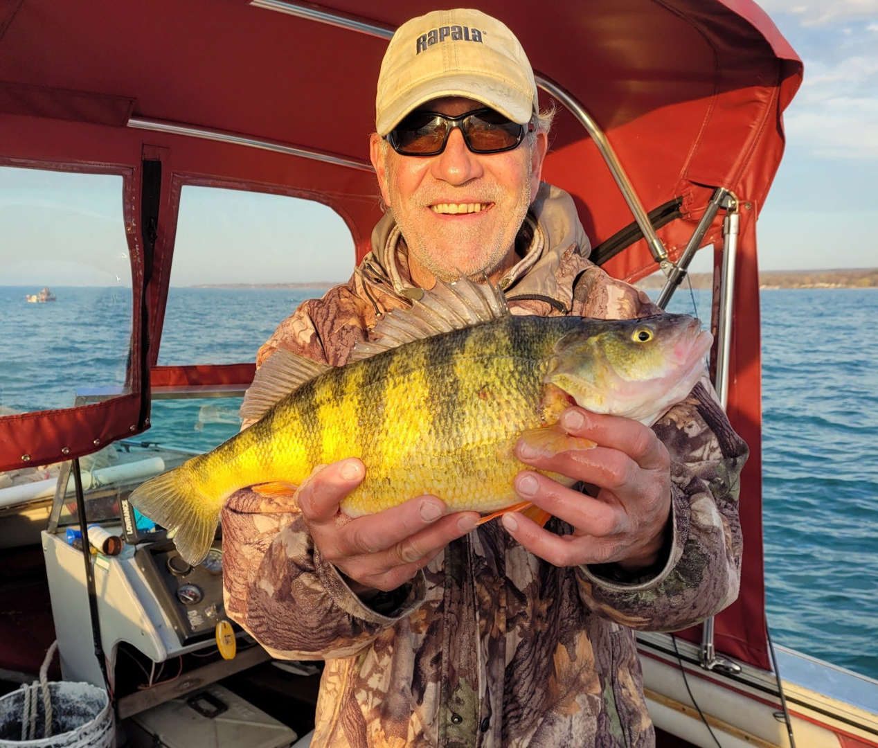 Man catches the state-record perch for Pennsylvania.