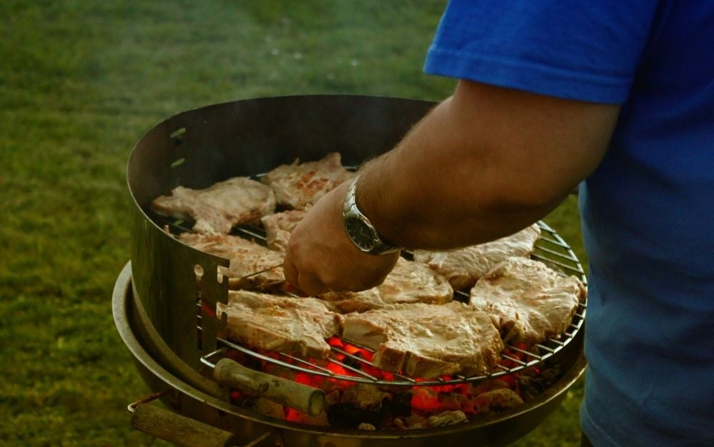 Chops cook on a grill top.