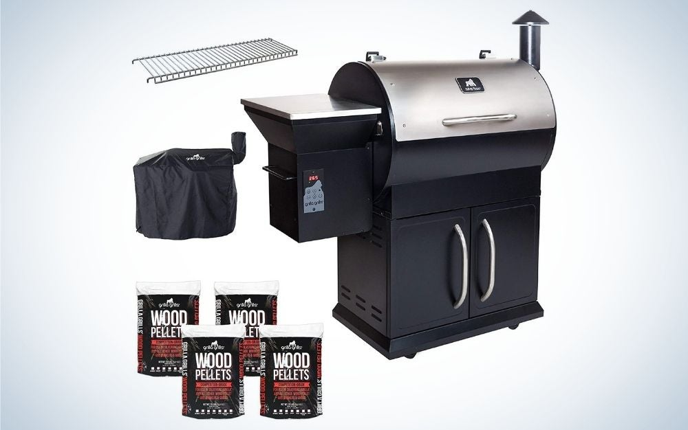 Silver and black electric wood pellet grill, with 4 bags of blend pellet fuel, a cover, and a upper rack extension