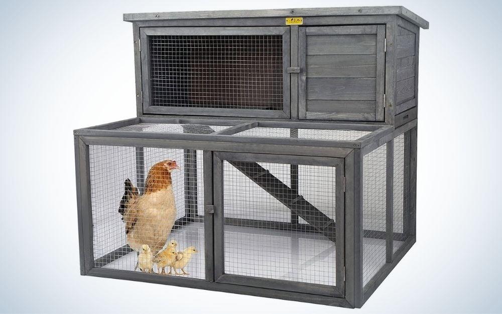 Large gray wooden chicken coop